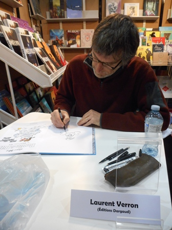 Laurent Verron, dessinant Bill
